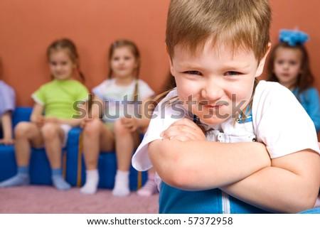 Preschooler, his friends behind him - stock photo