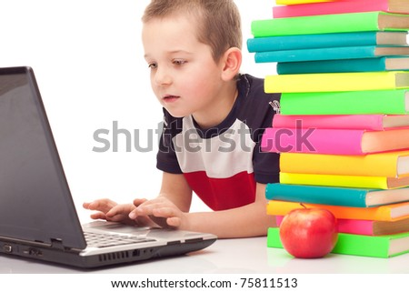 preschooler with lot of books and laptop on floor, isolated on background - stock photo