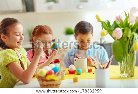 Preschoolers decorating Easter eggs - stock photo