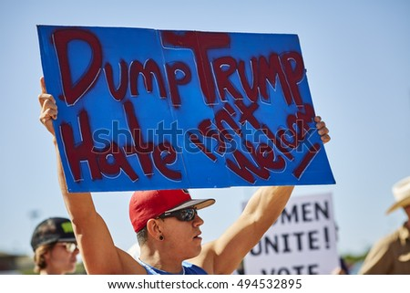 Prescott Valley, Arizona, USA - October 4, 2016: Protester holding up a hate sign at Donald Trump Campaign Rally in Prescott Valley, Arizona