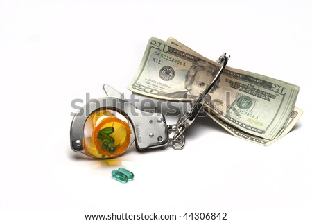 Prescription Bottle Handcuffed with money