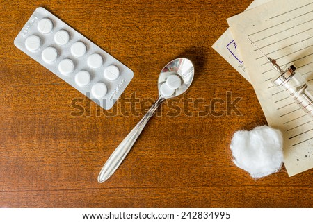 Prescription for the treatment of the disease, a tablets with a syringe on the table. Top view - stock photo