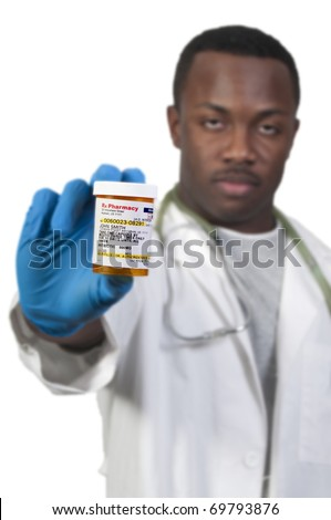 prescription medication pill bottle being held by a blurred Black man African American doctor - stock photo