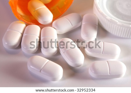 Prescription Pain Pills spilling out of a bottle