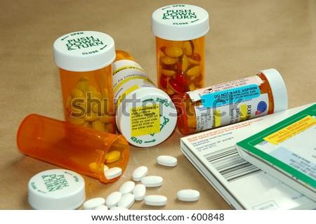 Prescription pills, drug bottles, instructions and warnings. - stock photo