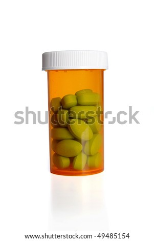 Prescription pills in container over white background