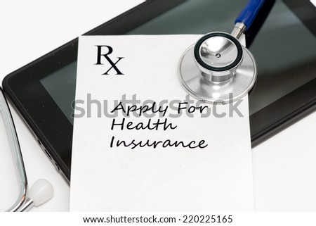 Prescription to apply for health insurance with personal computing tablet and stethoscope. - stock photo