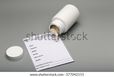 Prescription vitamins and pill bottle - stock photo