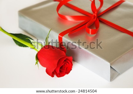 Present box and red rose - stock photo