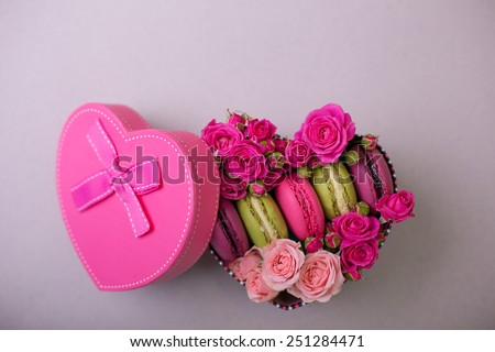 present box heart shape with flowers and macaroons background for valentines mother day easter with love - stock photo