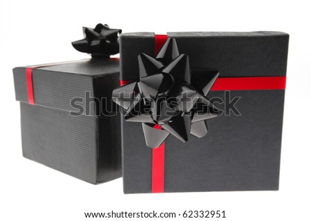 present box on white tied with red type - stock photo