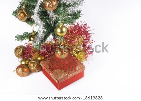 Present box under the Christmas tree isolated on a white background.