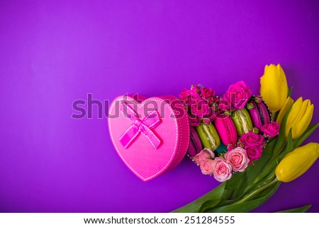 present box with flowers macaroons and tulips violet background for valentines mother day easter with love - stock photo