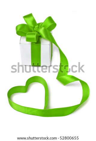 present box with green ribbon in the form of hearts isolated on white background - stock photo