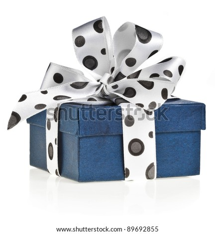 present box with   spotted ribbon bow isolated on white - stock photo