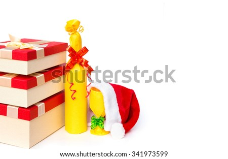 present boxes and wrapped wine and cup and santa claus hat with copy space on white - stock photo