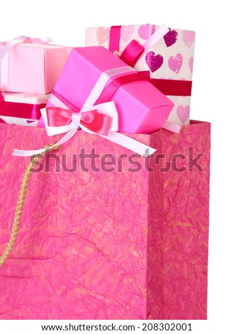 Present boxes in paper bag close up
