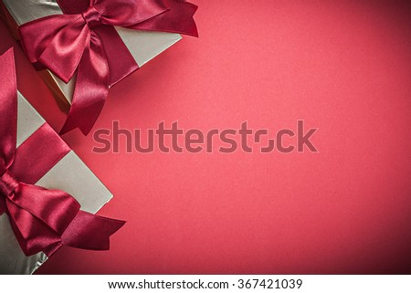 Present boxes on red background close up view holidays concept. - stock photo