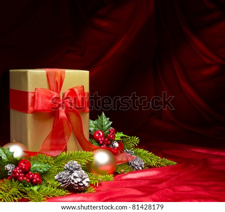 Present decorated with red satin and Christmas decoration, with space for advertising text - stock photo