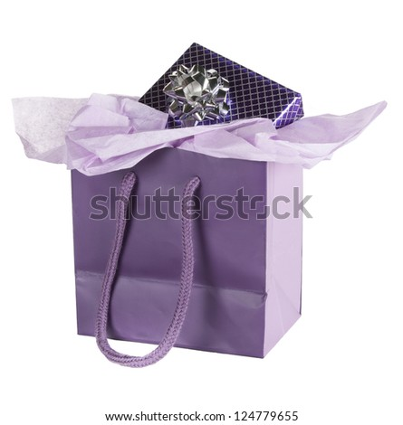 Present in silver-lined, purple foil paper with silver bow in purple gift bag with lavender tissue paper - stock photo