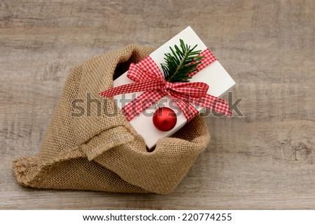 Present lying in santa bag - stock photo
