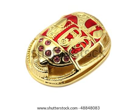 Present of travel - Golden egyptian Scarab - stock photo