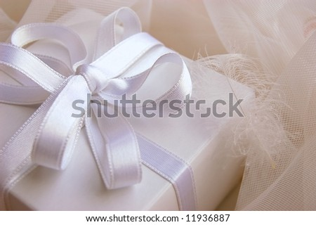 Present white box with silky ribbon in laces - stock photo