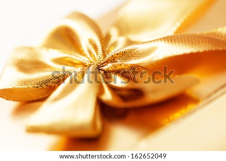 present with gold bow - stock photo
