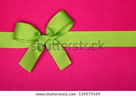 Present with green ribbon bow - stock photo
