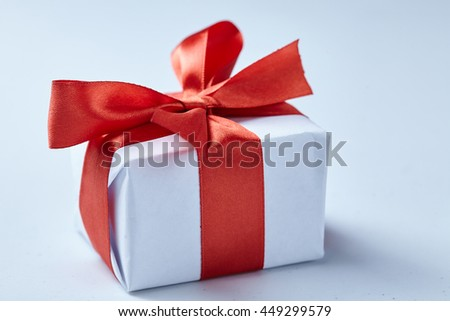 present with red bow - stock photo