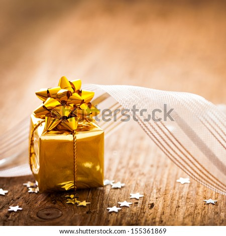present with ribbon on wood with copy space - stock photo