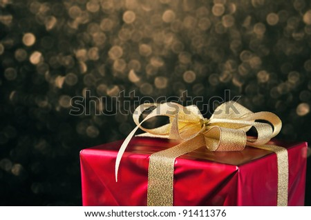 Present with soft defocused lights background - stock photo