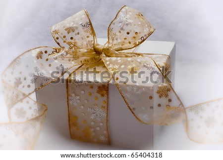 Present wrapped with beautiful bow - stock photo
