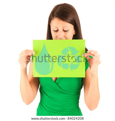 Presentation - Cute young brunette girl with a earth friendly ecology sign in her hand
