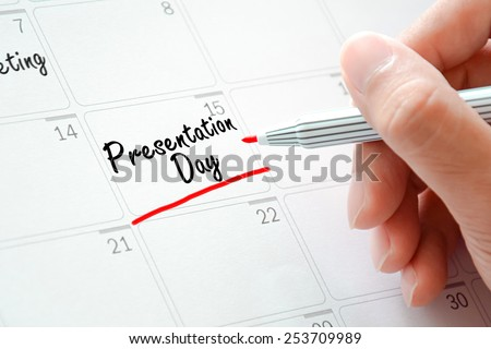 Presentation Day texts on the calendar (or desk planner) underlined with red marker