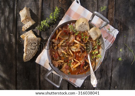 Presentation of a dish with mushrooms pioppini stewed with tomatoes - stock photo