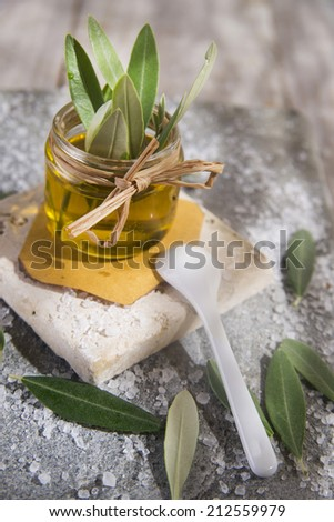 Presentation of a small glass jar containing olive oil