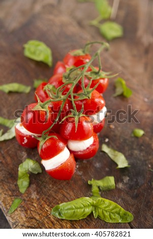 Presentation of the dish of the summer season, fresh tomato and mozzarella - stock photo