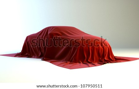 Presentation of the new car - automobile covered with a red cloth - stock photo