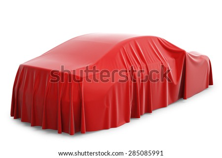 Presentation of the new car. Car covered with a red cloth. - stock photo