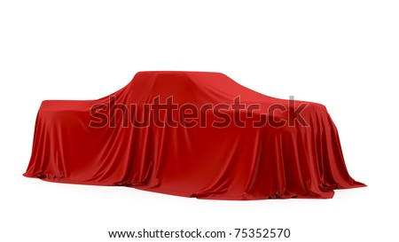 Presentation of the pickup truck. Autoshow. Car under the tissue. - stock photo