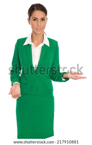 Presenting isolated businesswoman in green suit presenting new product over white. - stock photo