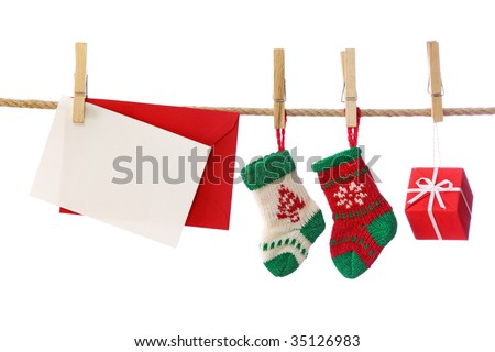 Presents and blank note isolated on white background - stock photo