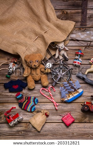 Presents and gifts of Santa's sac: old wooden antique toys for children. - stock photo