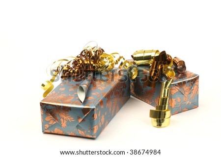 presents decorated with gold ribbons on a white background