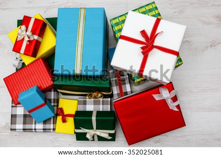 Presents presented stacked in a lot of colors and sizes  - stock photo