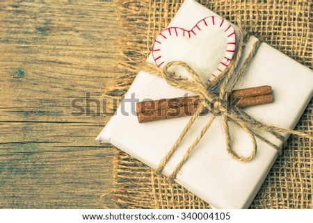 Presents with red heart on wooden board for valentines day - stock photo