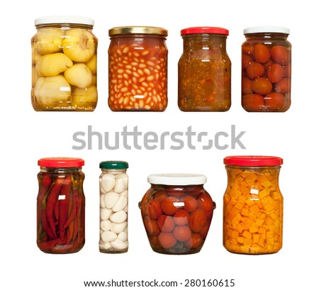 Preserved carrots, tomatoes, garlic, chilli, beans on white background