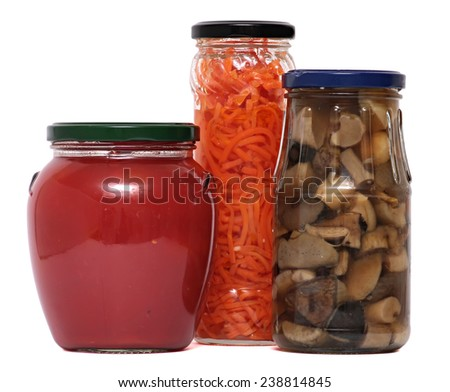 Preserved food in glass jars, isolated on white background. Various marinaded food  - stock photo