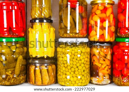 Preserved food in glass jars. Various marinaded food - stock photo